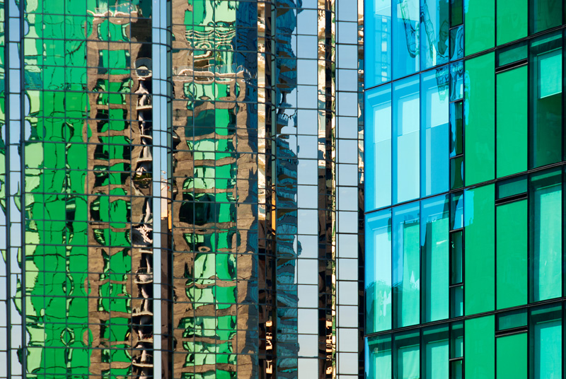 Combining a green tower in Vancouver, B.C. and it's reflection in the nearby building with the use of a telephoto lens.