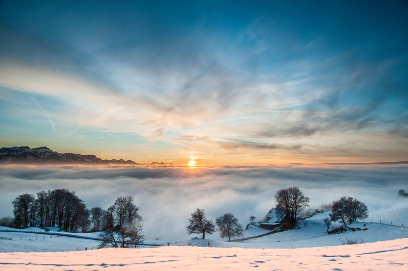 During the winter months, there often is a low cloud cover over Lake Geneva, Switzerland. Climbing Mont Pelerin allows one to rise above the clouds and enjoy some stunning scenery.