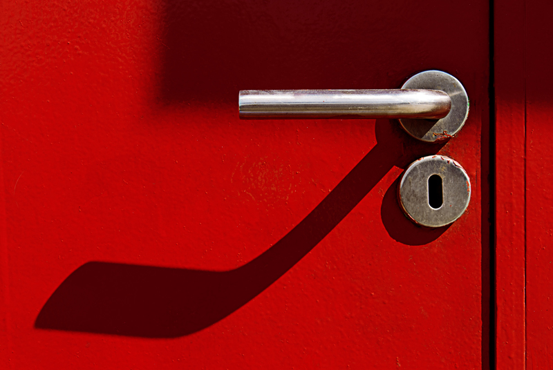 Shiny door handle of red door on Leith Walk, Edinburgh
