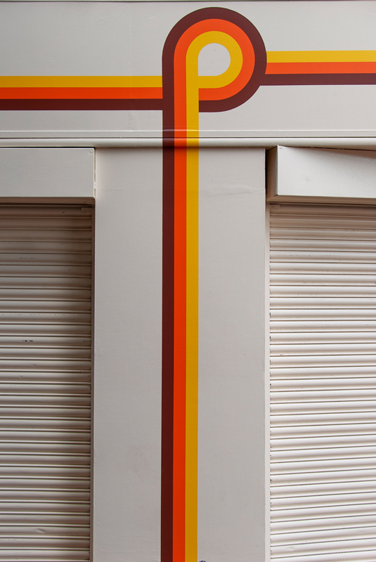 Brightly coloured lines on a shop front on Leith Walk, Edinburgh