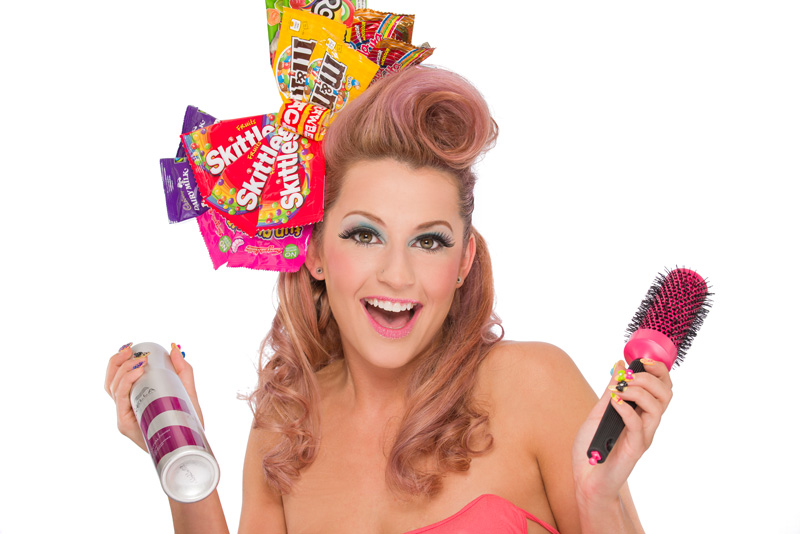 Beauty model with Candy Girl themed hair, makeup, having a great time doing her hair.
