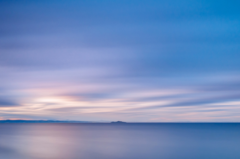 Cramond Island, Edinburgh, from Portobello beach seascape. Taken with a long exposure in July.