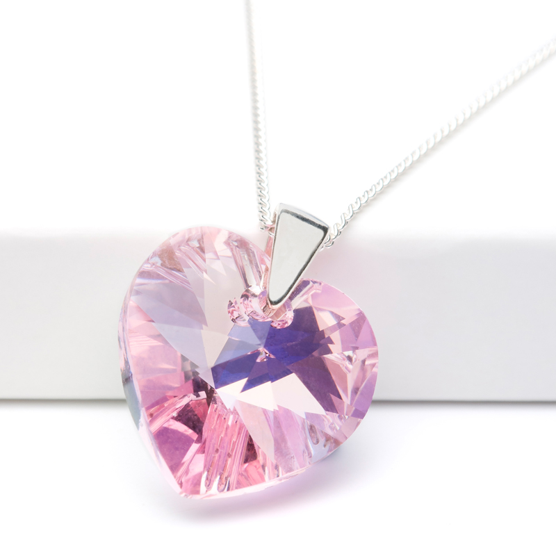 Jewellery product shot of pendant designed by Candle Jewellery. Pink and sparkling.