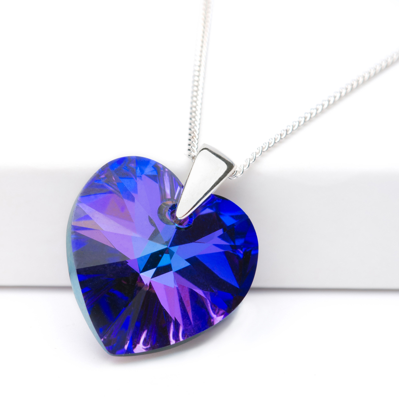 Jewellery product shot. Deep blue coloured pendant designed by Candle Jewellery.