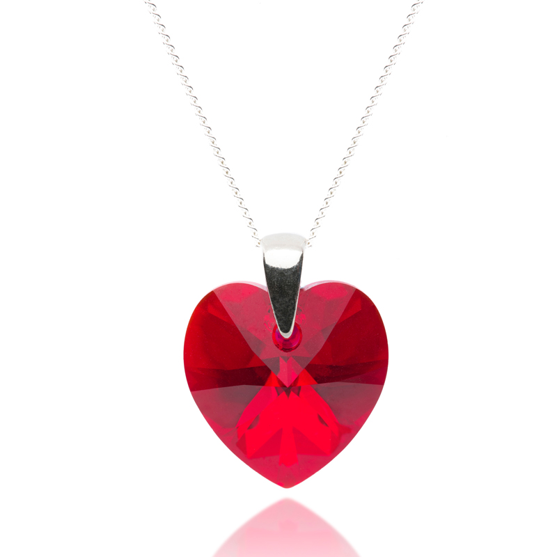 Jewellery pendant product photograph. The red pendant was designed by Candle Jewellery.
