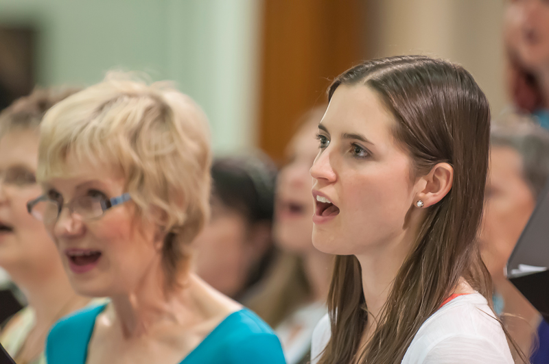 Close-up photograph of one of the female members of the Edinburgh City Singers