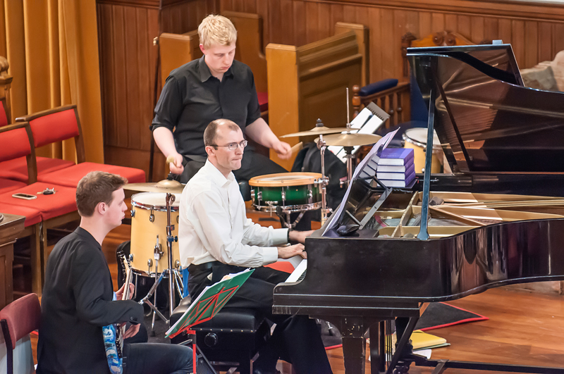 Photograph of the pianist, guitarist and drummer accompanying the Edinburgh City Singers choir at their St Cuthbert's concert