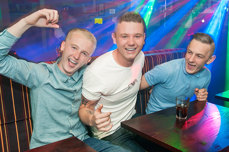 Three young men having a great time at Madisons nightclub, Musselburgh