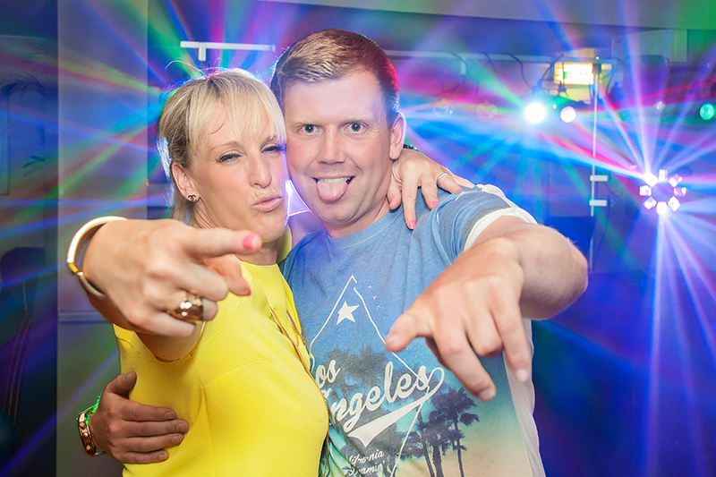 Lady and man pointing to the camera with a funny expression on their faces at Madisons nightclub, Musselburgh