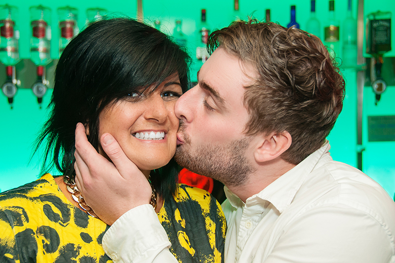 Young man kissing young lady on the cheek, in front of the bar at Madisons nightclub, Musselburgh