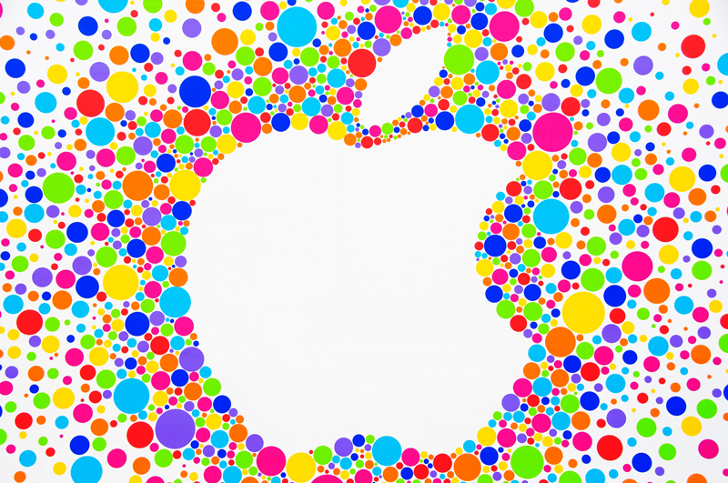 Apple logo emerging out of a pattern of colourful dots on wall surrounding the new Edinburgh Apple store