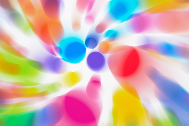 Colour abstract of dots obtained by zooming and moving the camera during a long exposure