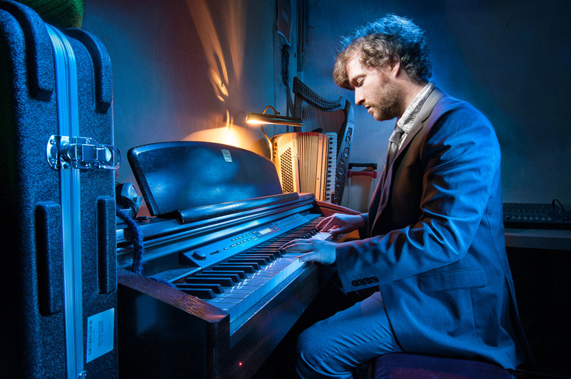 Composer and audio producer Frankie Lowe at the piano light painting