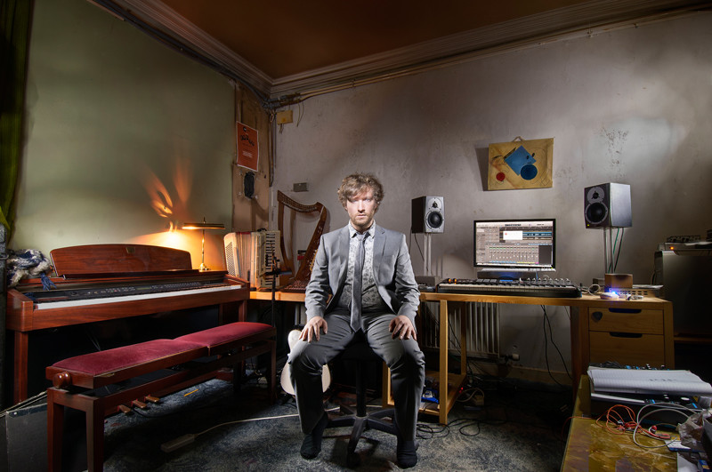 Light painting of composer and audio producer Frankie Lowe in his recording studio