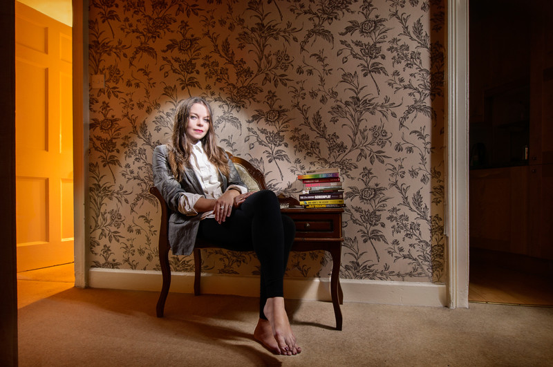 Light painting of actress, writer and performer Juliette Burton in her Edinburgh flat, sitting in a chair