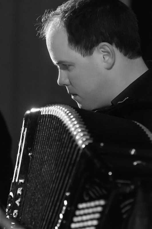 Paul Chamberlain playing the accordion at ceilidh event in Summerhall, Edinburgh, with Hotscotch band