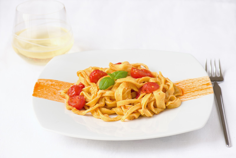 Home made tagliatelle with tomatoes prepared by Italian chef Chiara Scipione
