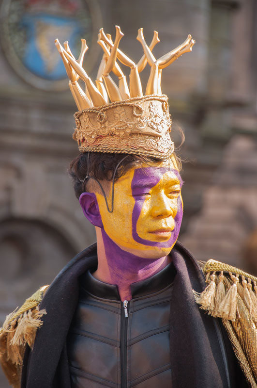 Young Asian man in a King costume
