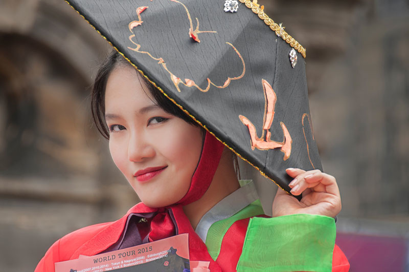 Portrait of young Asian lady wearing a red dress and black hat
