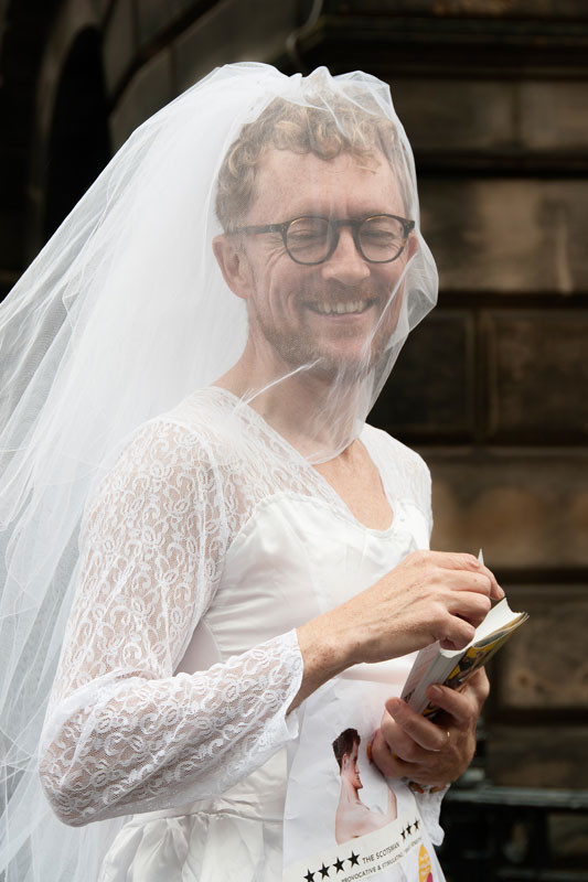 Man In Wedding Dress Promoting The Show This Much By Moving Dust Company