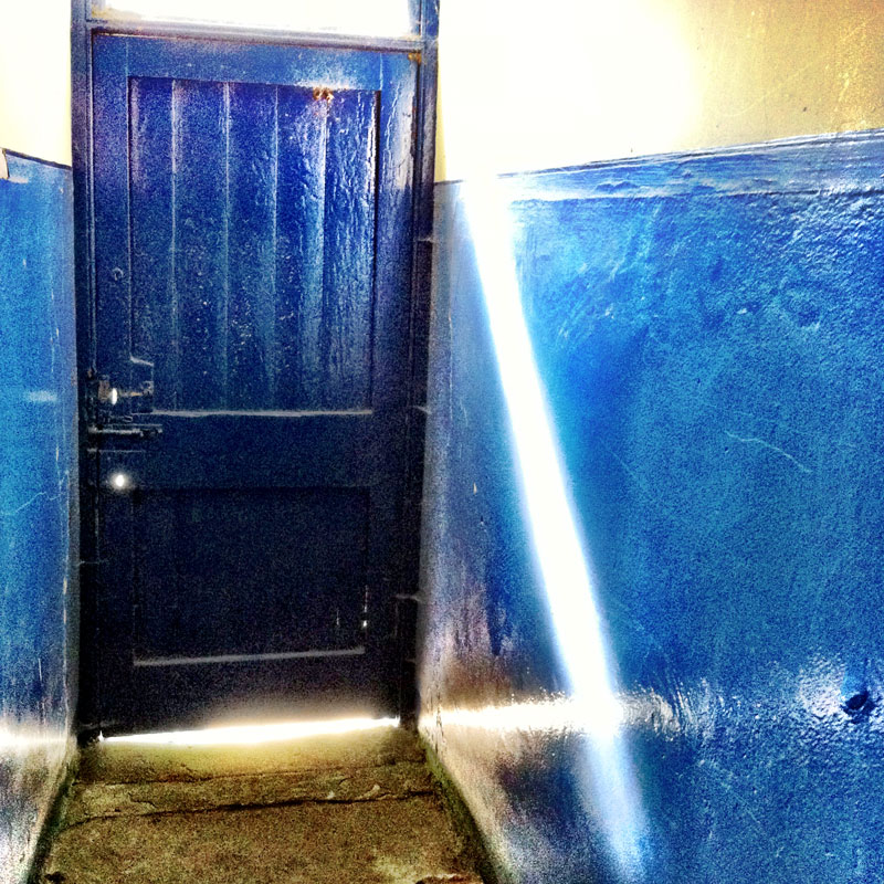 Ray of light and blue door. Clarity filter in Camera+, Taken with iPhone.