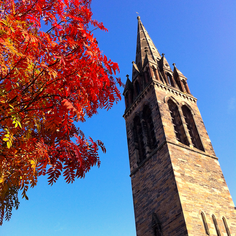 St Peter's church, Edinburgh, fall colours, tree, and blue sky. Shot on iPhone.