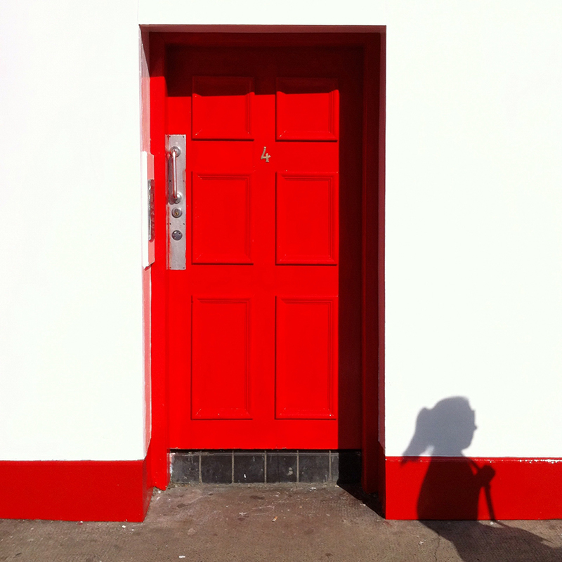 Red door with shadow of person. Taken with iPhone