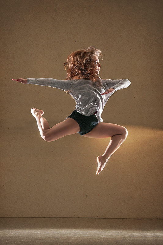 Female dancer Kaja Jurkowska jumping. Profile picture