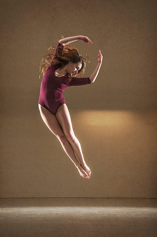 Female dancer Kaja Jurkowska jumping. Frontal picture.