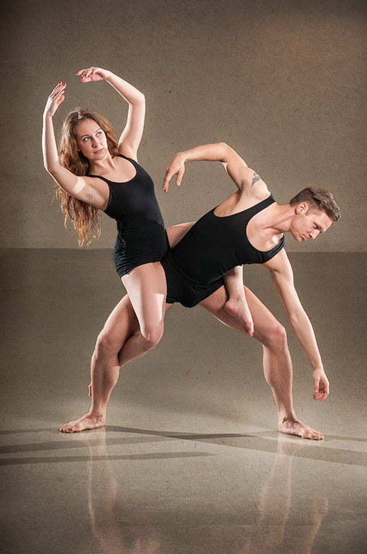Male and female dancer in action. Vertical photo.