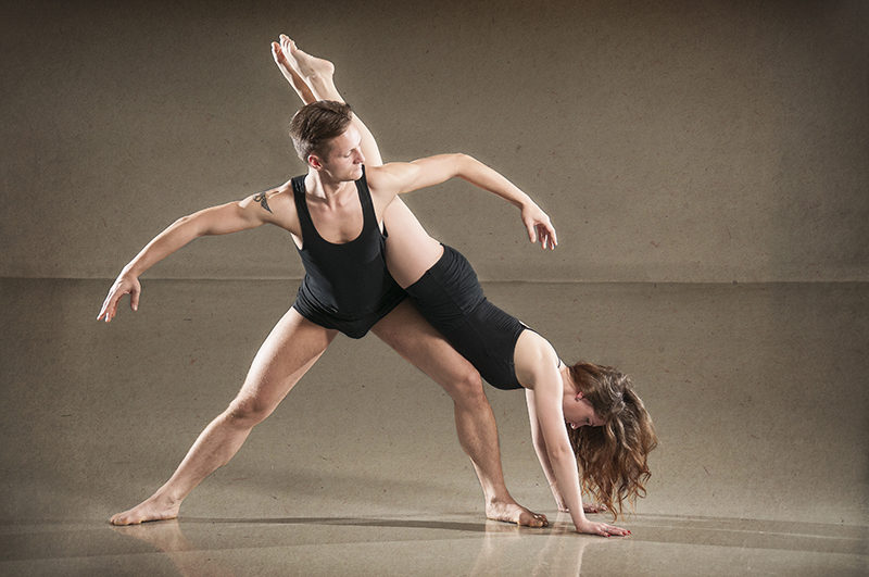Male and female dancers in action. Horizontal photograph