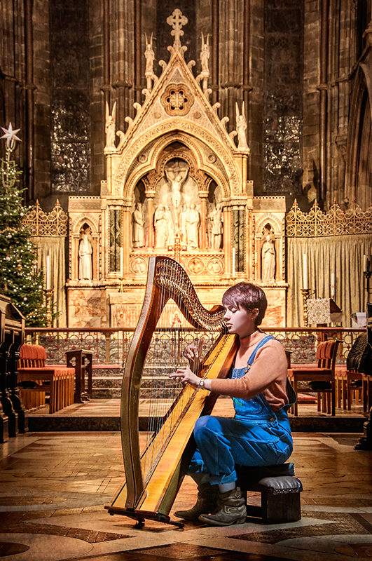 The Voice UK 2014 contestant Anna McLuckie with her harp light painting in from of the altar at St Mary's cathedral , Edinburgh