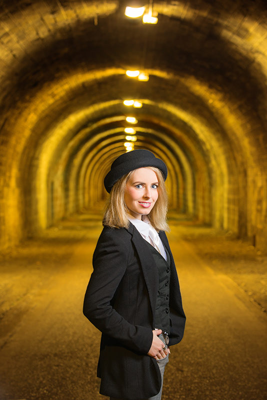 Smiling model framed by the arches at the Innocent Railway Tunnel, Edinburgh