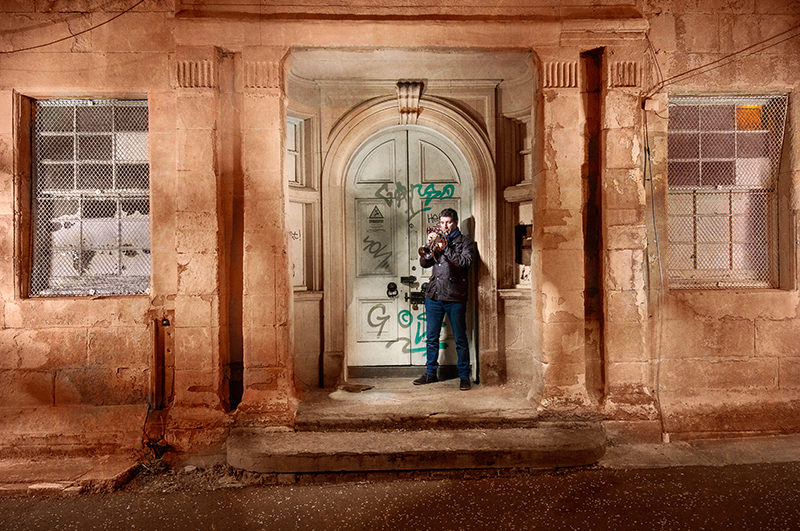 Light painting of musician and educator Finlay Hetherington with his trumpet in an urban location