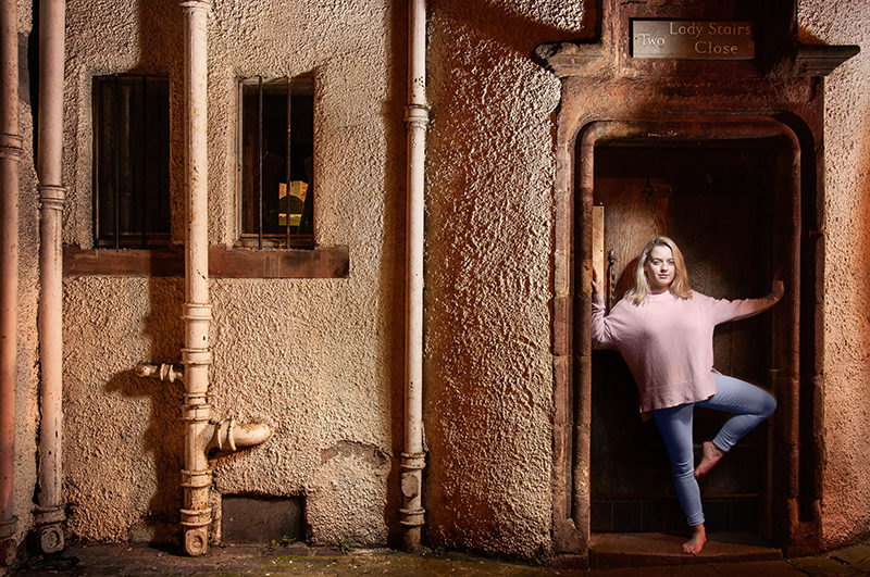Light painting of model in a close by  the Royal Mile in Edinburgh, Scotland