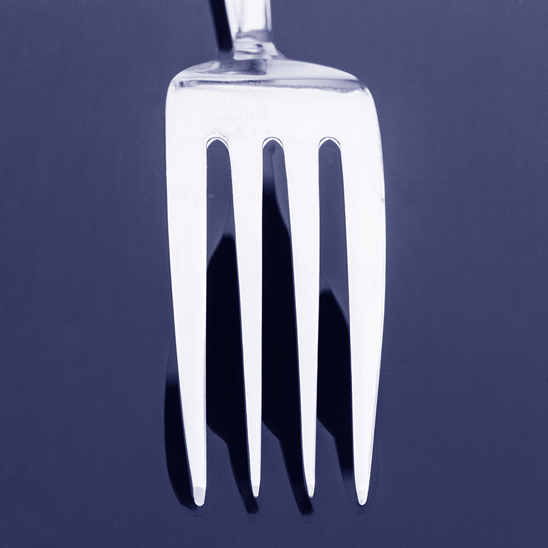 Fork on black reflective background edited with a Photoshop Duotone