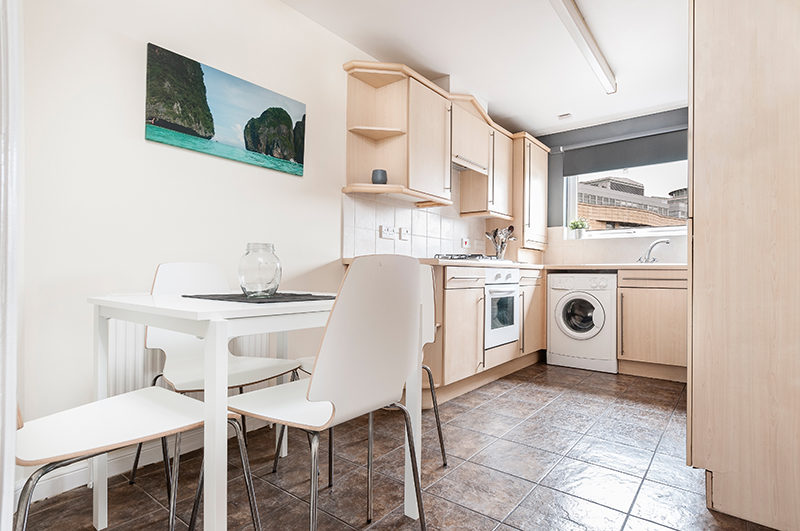 Kitchen with dining table in rental flat. Leith, Edinburgh