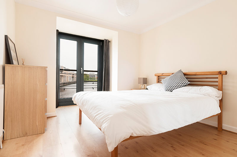 Bedroom with lovely view  in rental flat. Leith, Edinburgh
