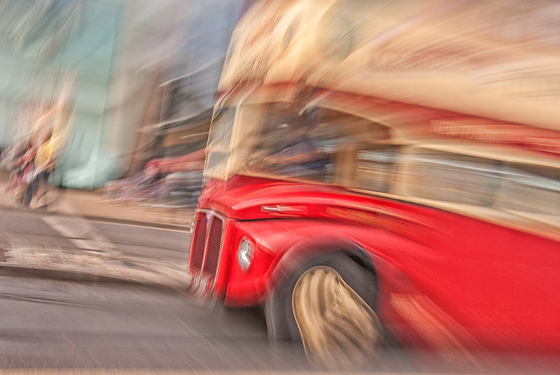 Edinburgh tour bus, impressionist photography using zooming and camera rotation