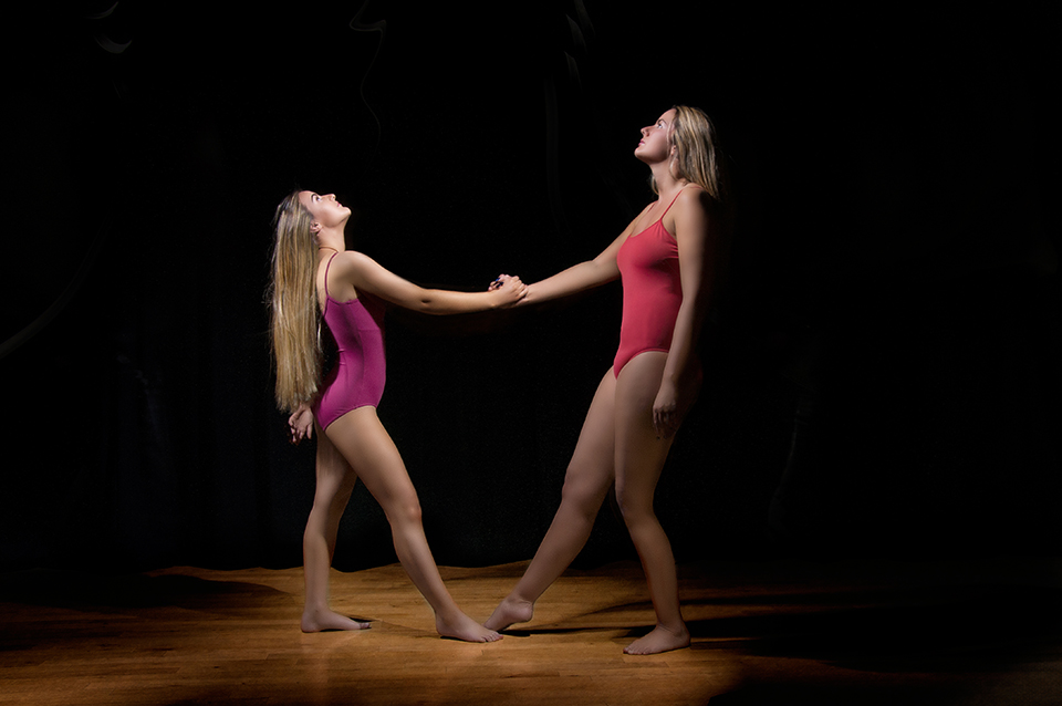 Light painting two dancers standing  in the middle of the Dance Base studio while holding hands