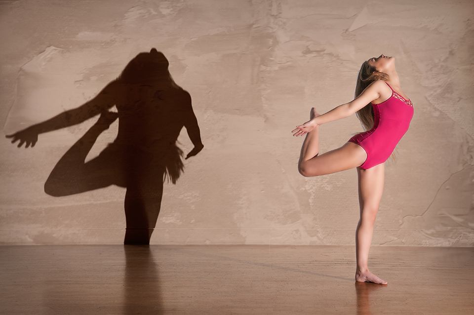 dancer and shadow on a light coloured wall at Dance Base, Edinburgh