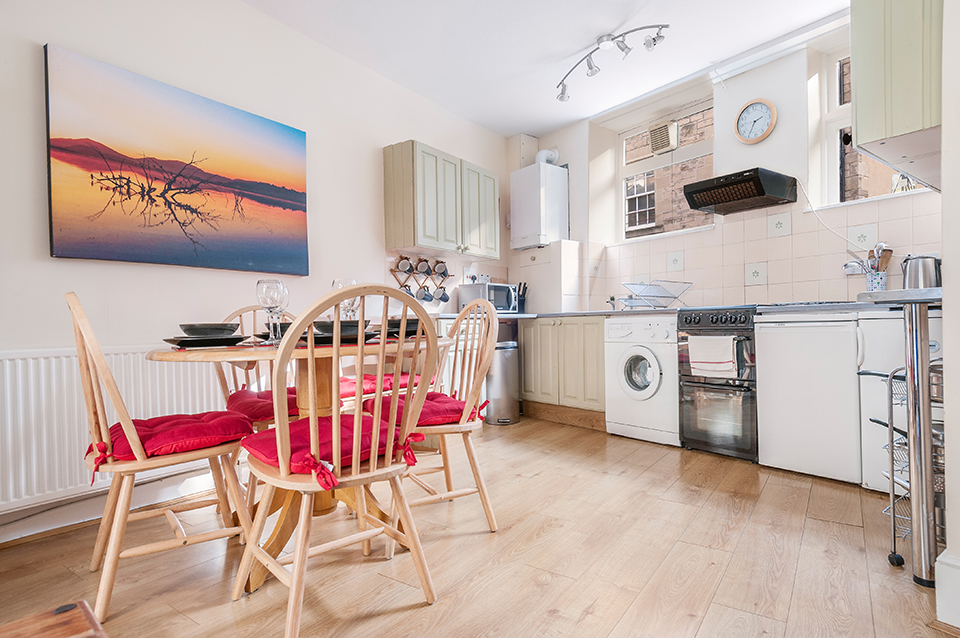 Dining table and kitchen, holiday let, Edinburgh